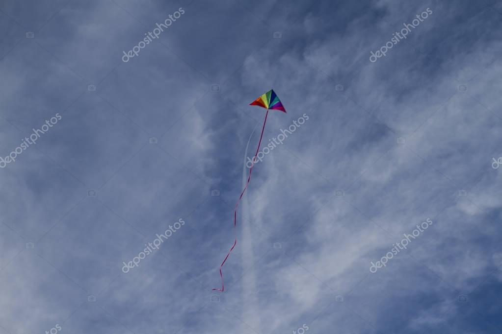 Kite of rainbow colors in sky