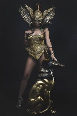 woman in goddess armor with egyptian statue