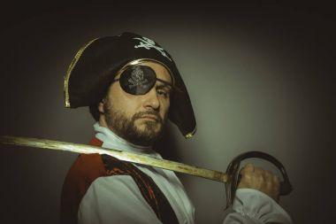 Man with beard dressed like a pirate