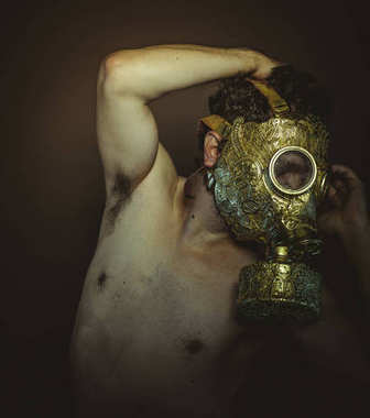 Pollution Man with gold gas mask and arabesques in poses of drowning and desperation, depression and psychiatry concept.