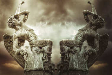 concept of fallen angel, demons and punishment of God. Devil sculpture in madrid, spain