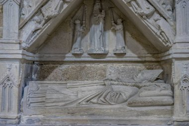 burial in stone of a Christian bishop in the interior of a religious cathedral in Spain