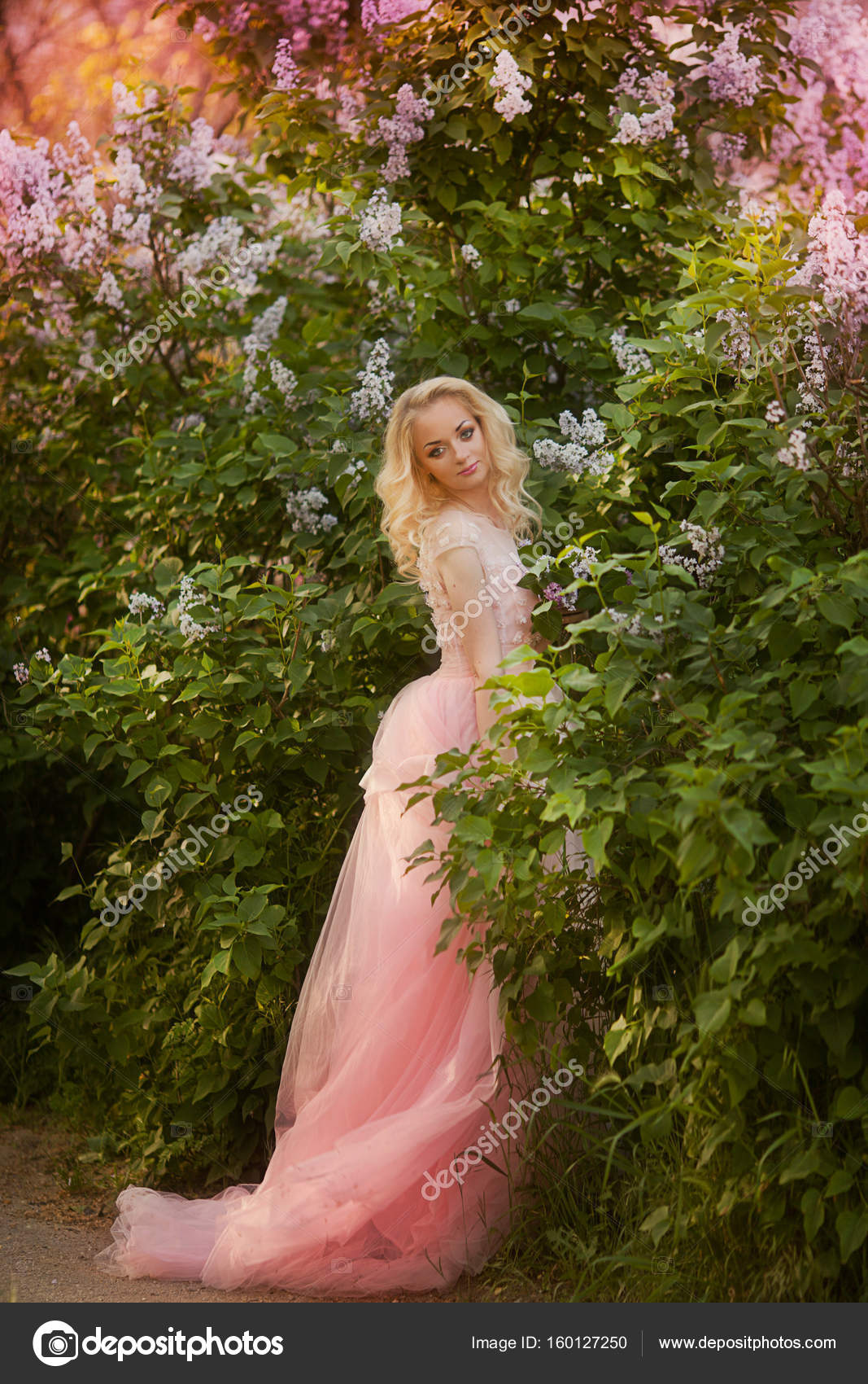 Beautiful woman enjoying lilac garden young woman with flowers in a girl in a lavender pink garden photo by olenakucher izmirmasajfo Image collections