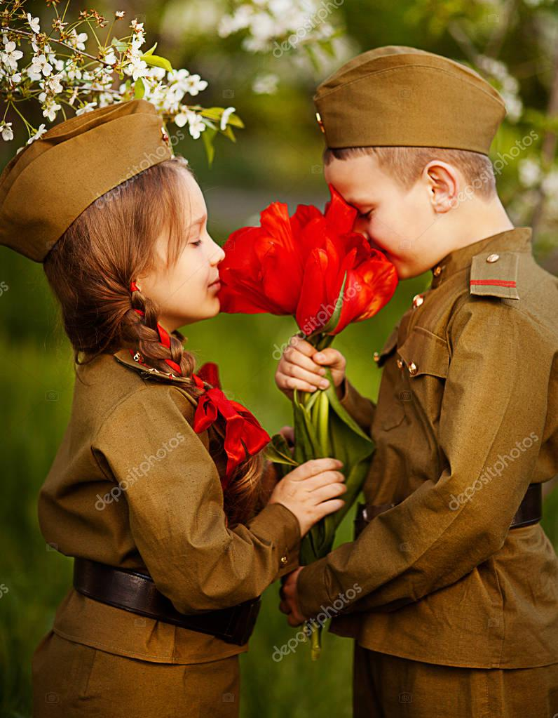 boy with a girl in military uniform.day of victory