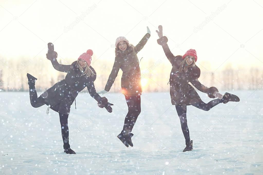 group of girls jumping in winter