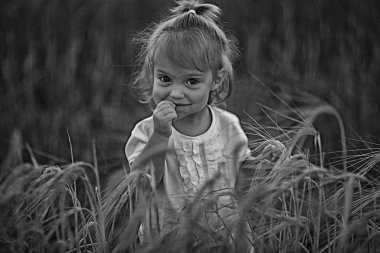young female child in a field