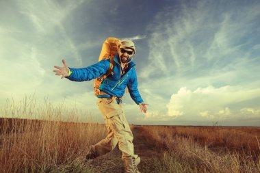man traveler in wildlife at autumn