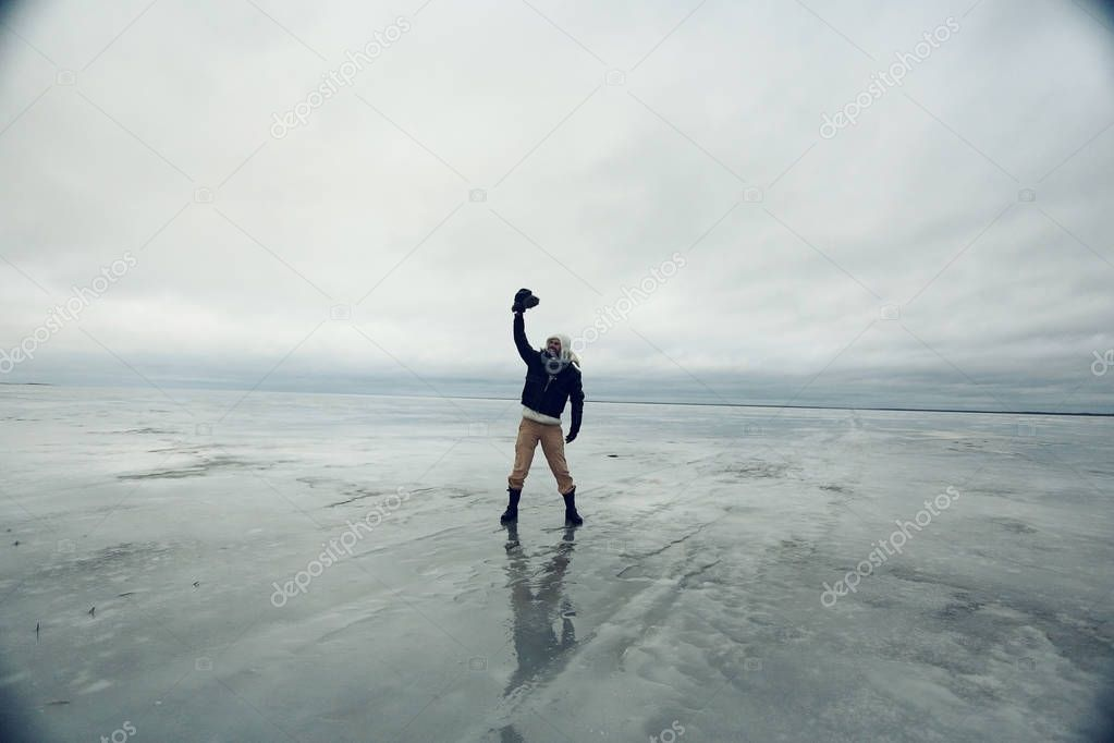 traveler man on the ice plain