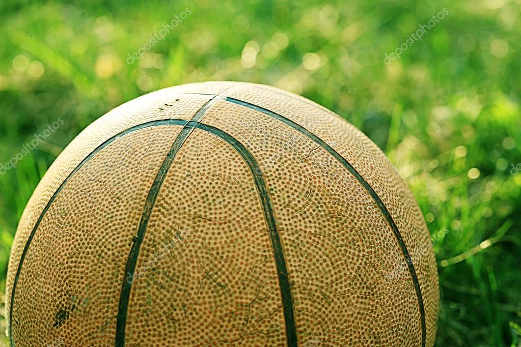 old basketball on grass