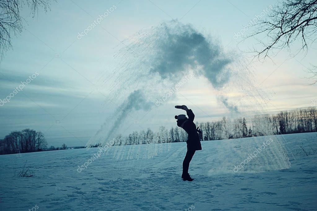 Man making fountain of snow