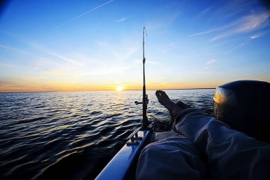 Fishing in the boat on the lake