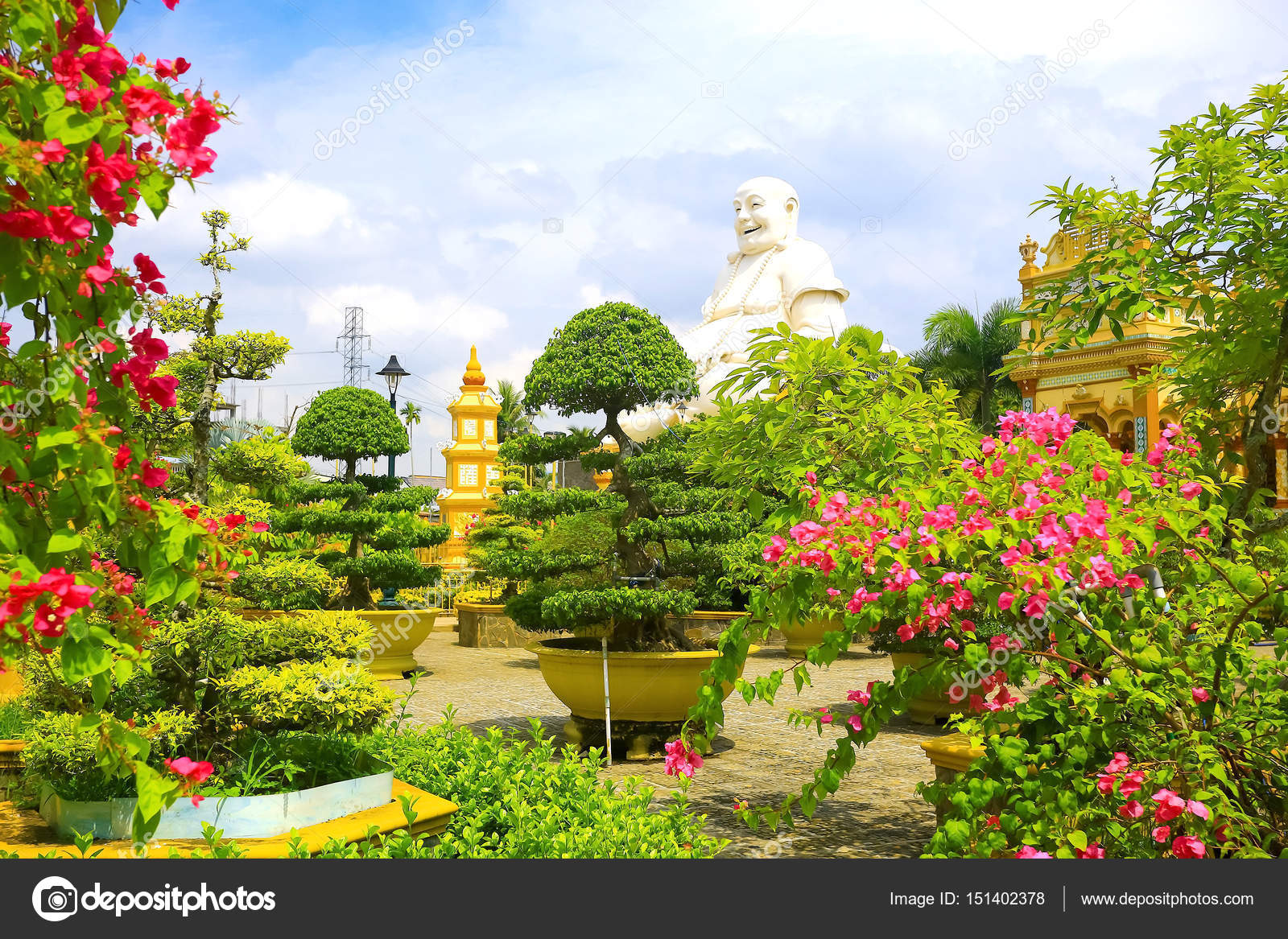 Tropical garden with flowers and trees \u2014 Stock Photo © xload