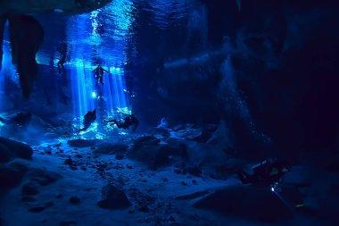 underwater world cave of yucatan cenote, dark landscape of stalactites underground, diver