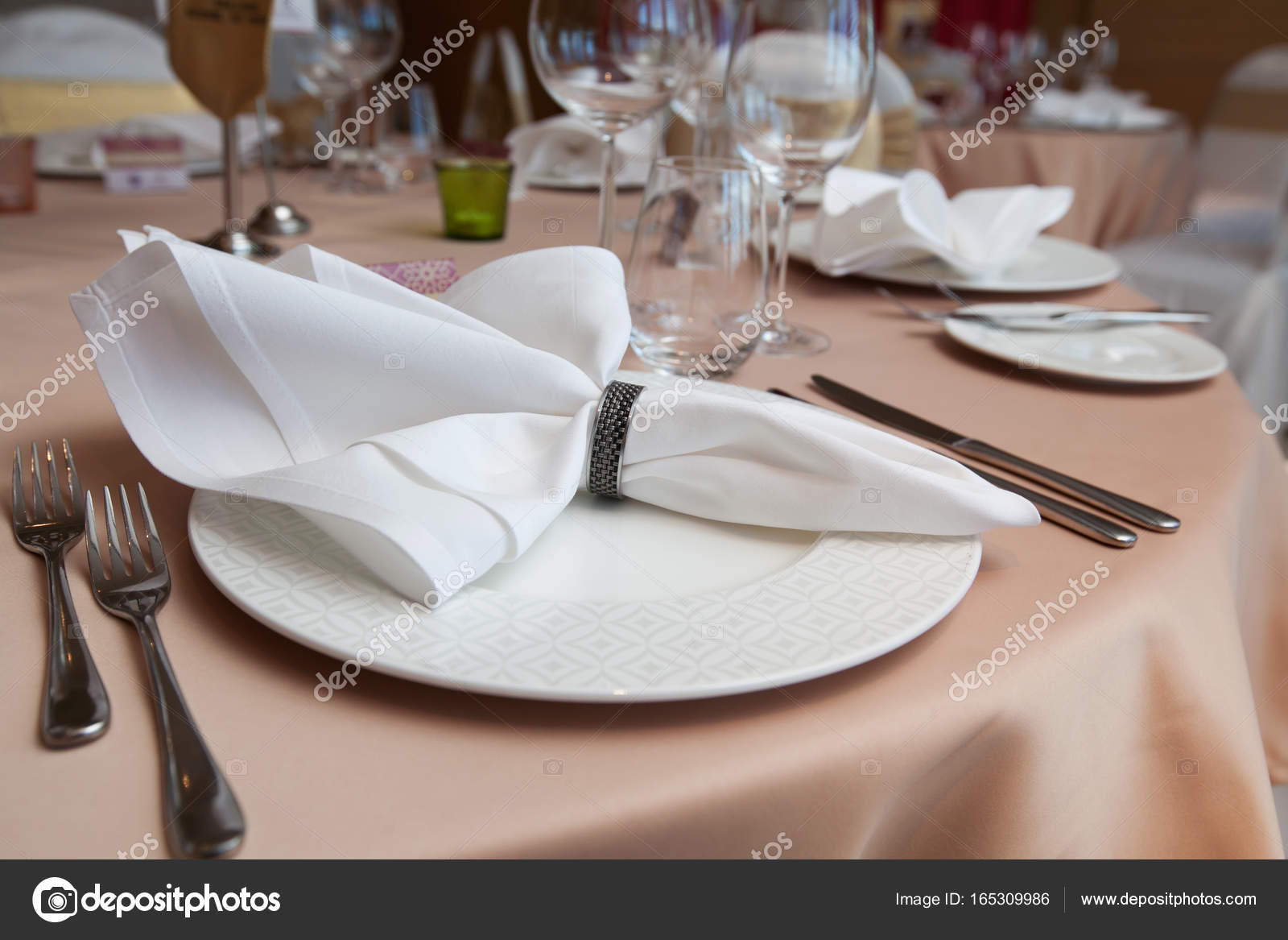 Set-up dinner room in the hotel. folded napkin laid on plate on the table at restaurant \u2014 Photo by Suwanphoto & set-up dinner room in the hotel. folded napkin laid on plate on ...