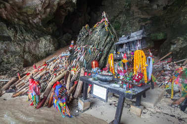 Wooden phalluses in Pranang cave. South Railay beach in Krabi, Thailand.This is a beliefs of here among villagers, In this cave has Princess Goddess resides.