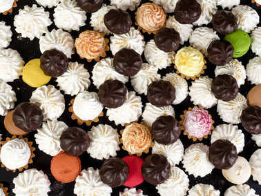 Assorted marshmallows in chocolate, meringues, cakes