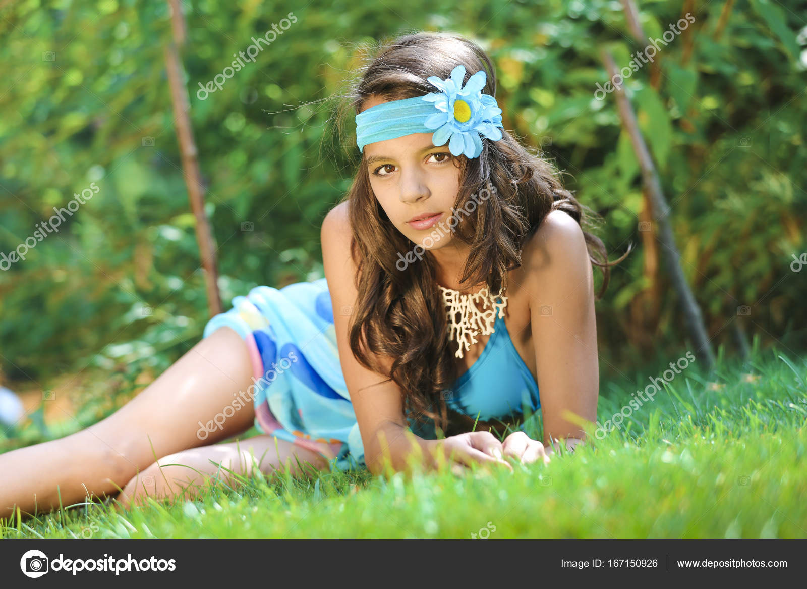Close up portrait of beautiful girl with a mysterious look charming close up portrait of beautiful girl with a mysterious look charming lady with pink head band with flower izmirmasajfo