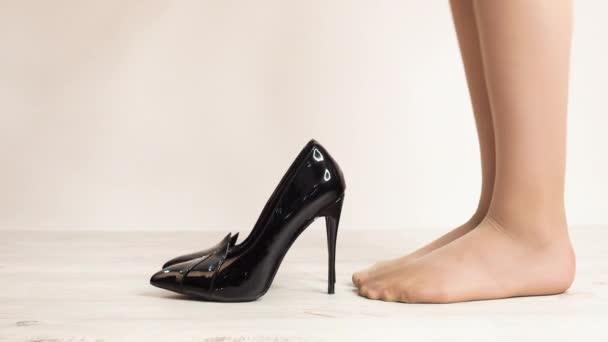 close-up footage of woman in stylish high heel shoes on white background
