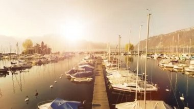 Magic hour sunset aerial viewwater lakesailboats dock pierpanorama horizon