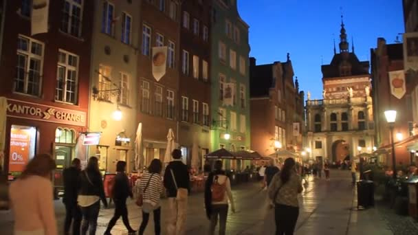 Evening view of people walk along Long Dluga street in Gdansk, Poland