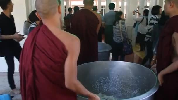 Monks of Kya Kha Wain Kyaung temple in Bago prepare their lunch.