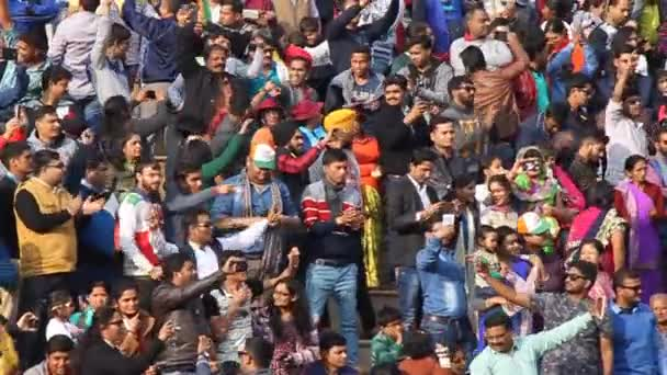 Crowd of Indian spectators watch the military ceremony at India-Pakistan border in Wagah