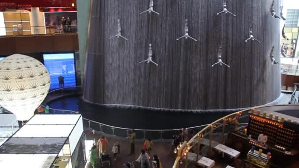 Human waterfall in the Dubai Mall, one of the largest malls in the world.