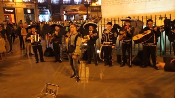 Group of Mariachi performing at Puerta del Sol square in Madrid.