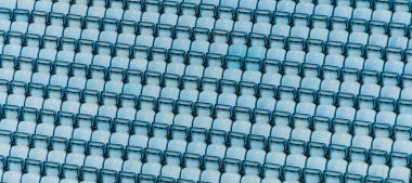 Rows of blue plastic stadium seats.
