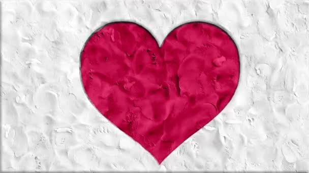 zastavení pohybu clay udělal kreslený tvar srdce ručně vyráběné jako animace tok dokumentů smyčky - nové kvalitní romantické svatební symbol video záběry