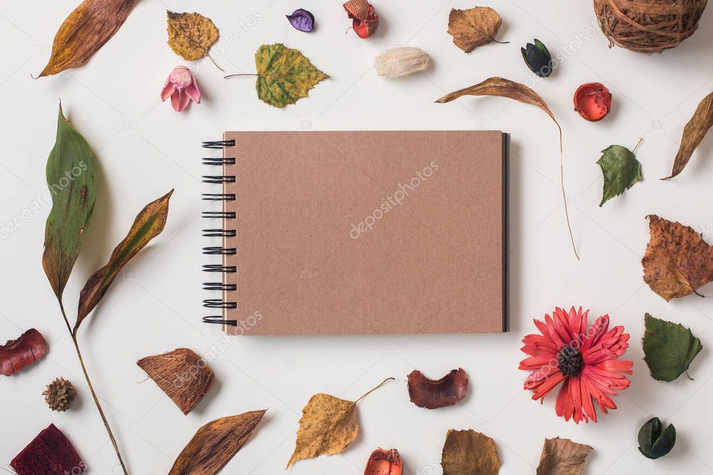 Autumn background with craft sketchbook mock up