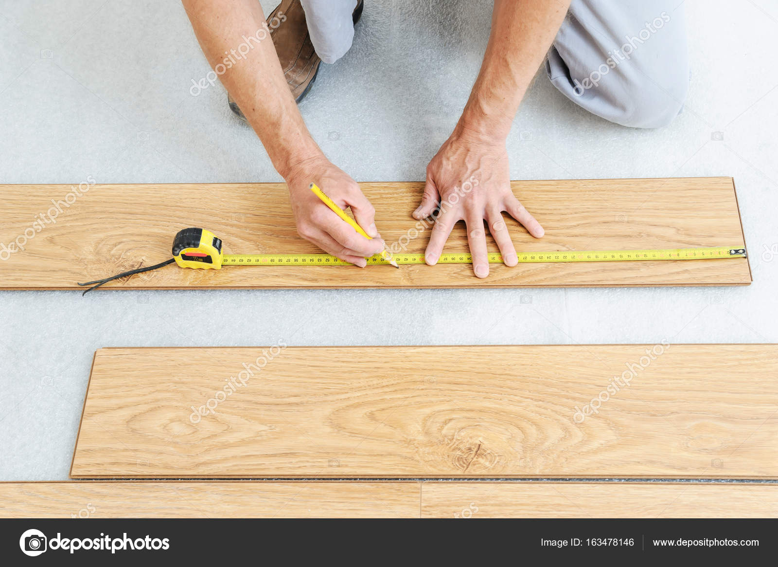 Installation Of A Laminate Floorboard Stock Photo