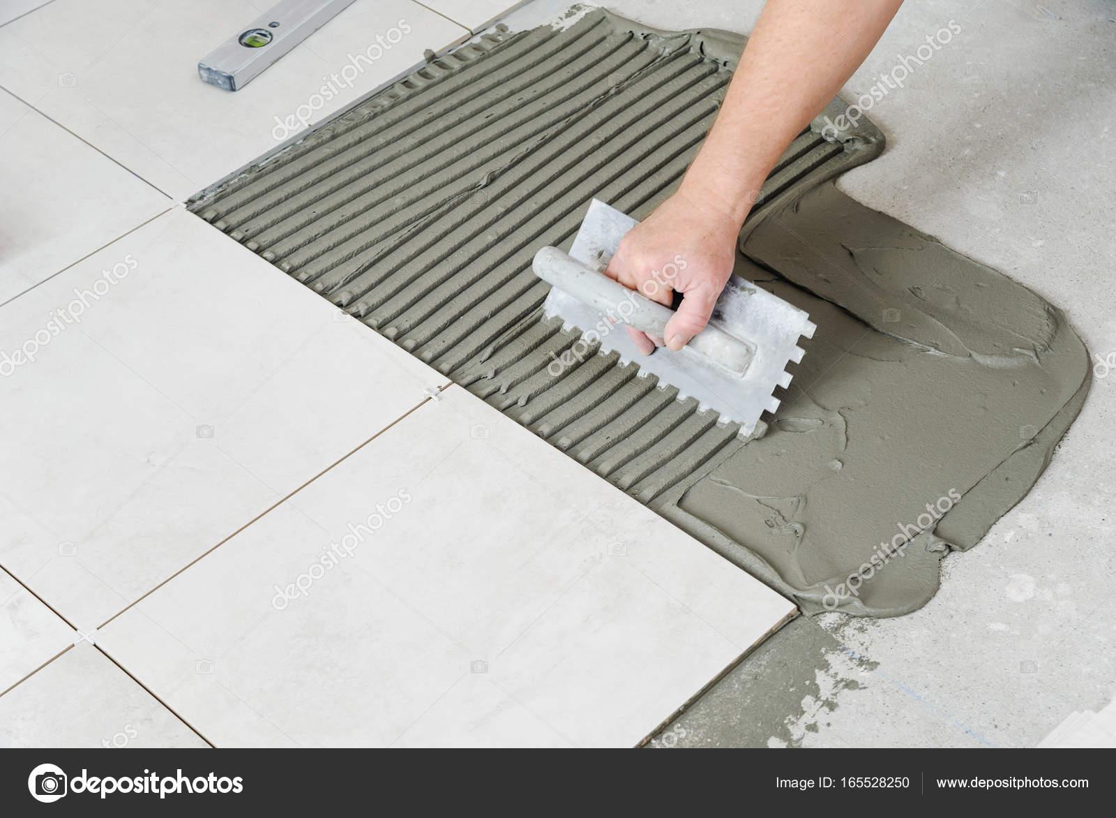 Laying Ceramic Tiles. — Stock Photo © Yunava1 #165528250