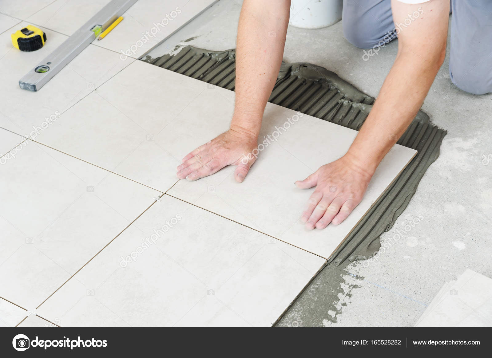 Laying ceramic tiles stock photo yunava1 165528282 laying ceramic tiles stock photo dailygadgetfo Choice Image