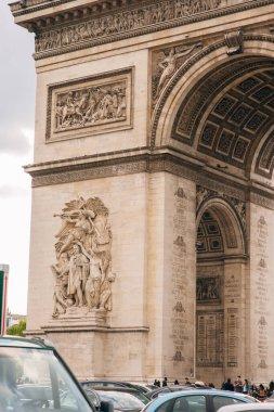 Architectural fragment of Arc de Triomphe. Arc de Triomphe de l'Etoile on Charles de Gaulle Place is one of the most famous monuments in Paris. France.