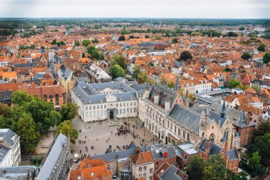 Panoramic view from the Belfort tower on the historic part of Bruges and the Cathedral of St. Salvator, the main pedestrian street with many shops, Belgium. Travel to Belgium. Aerial view