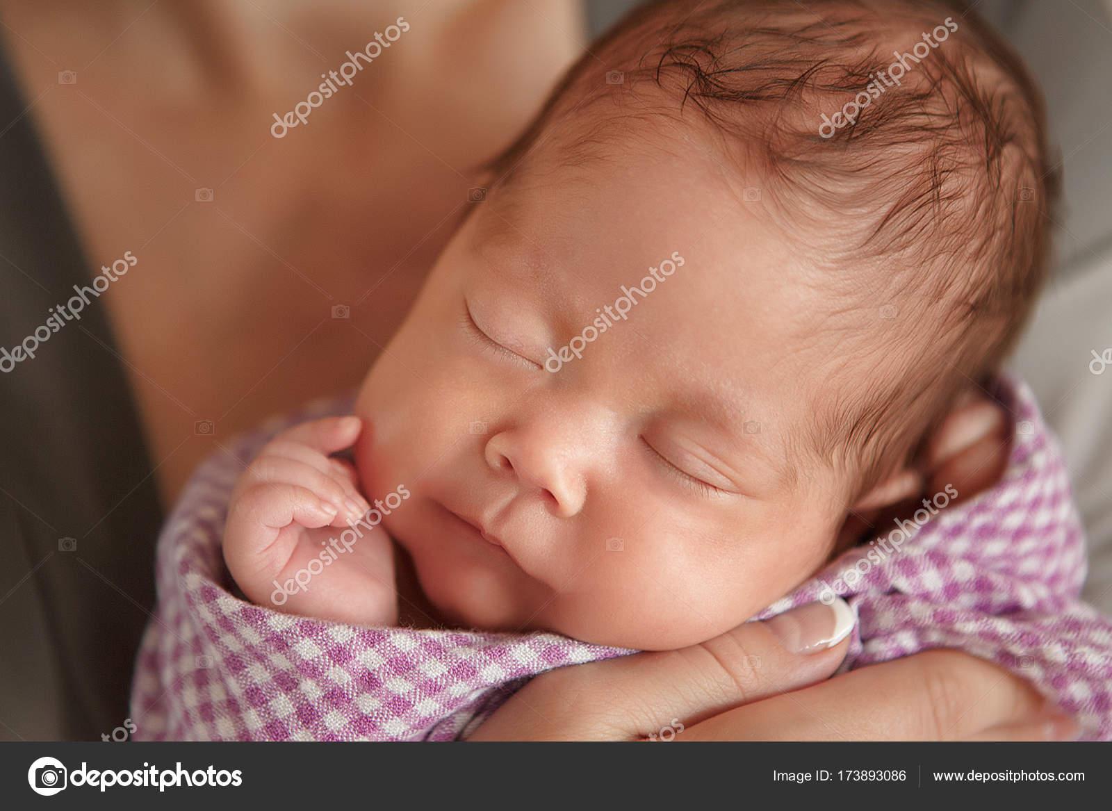fe7155a9b Newborn baby tender sleeping on wool couturier blanket. Pure human ...
