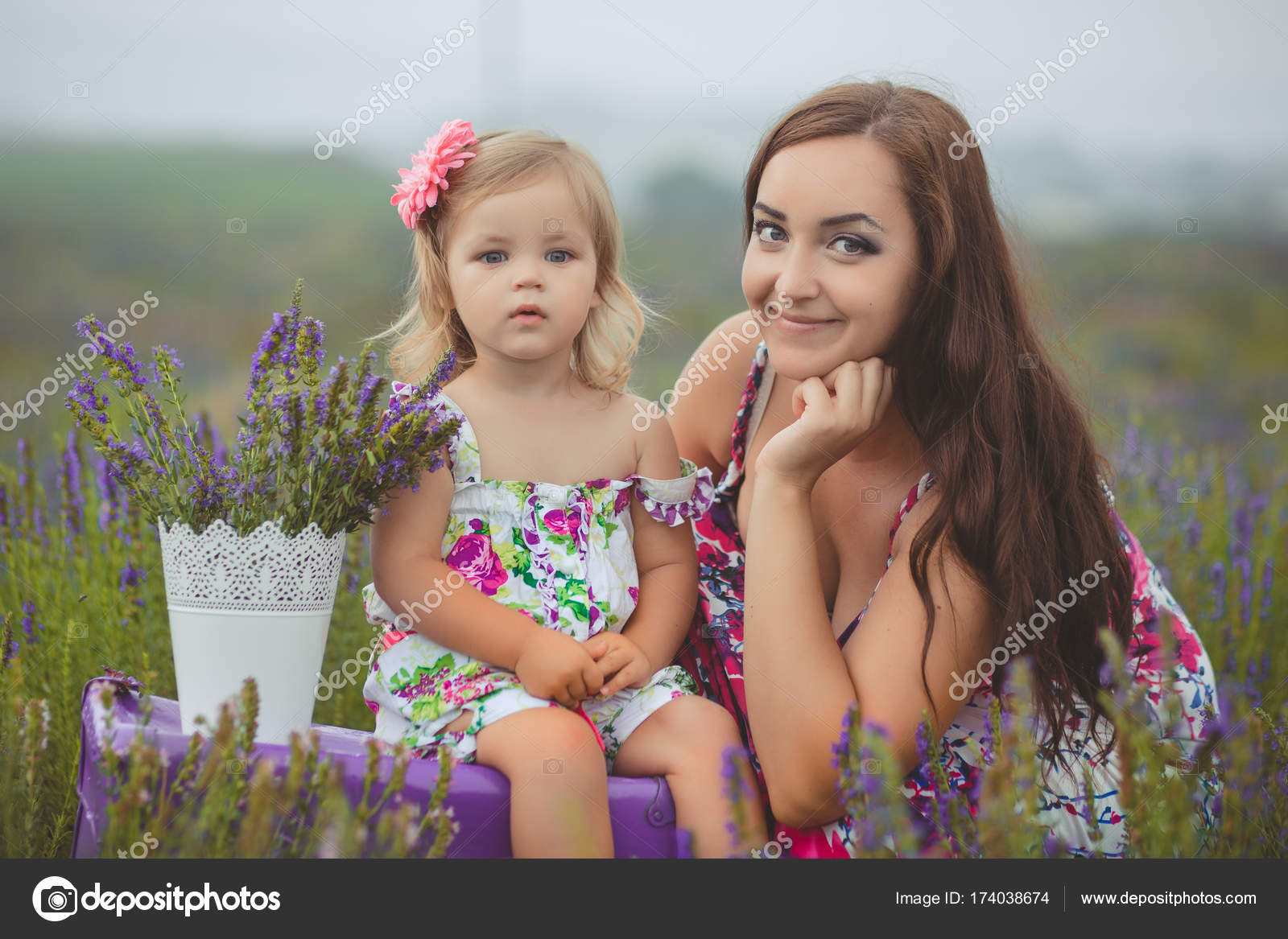 Happy Young Adorable Brunette Mother Mom Posing Kissing Her Tiny Little Daughter Child Girl In Lavender