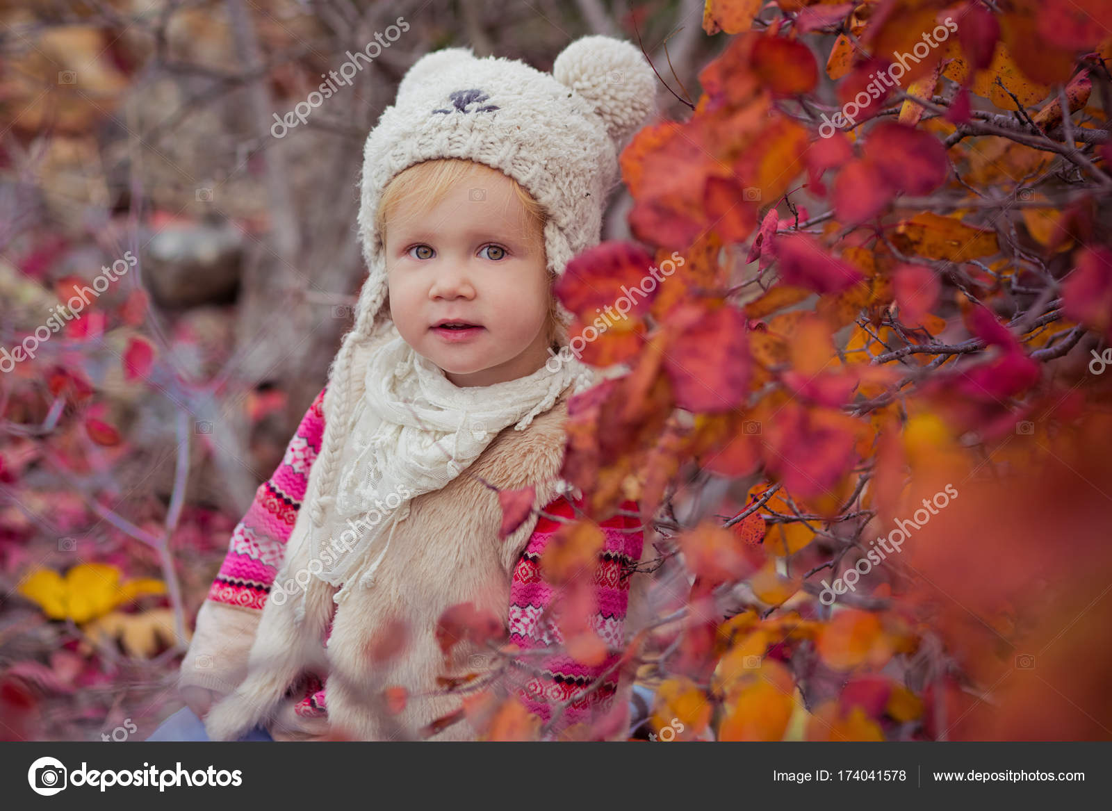 97360b980dda5 Cute young russian baby girl stylish dressed in warm white fur handmade  jacket blue jeans boots ...