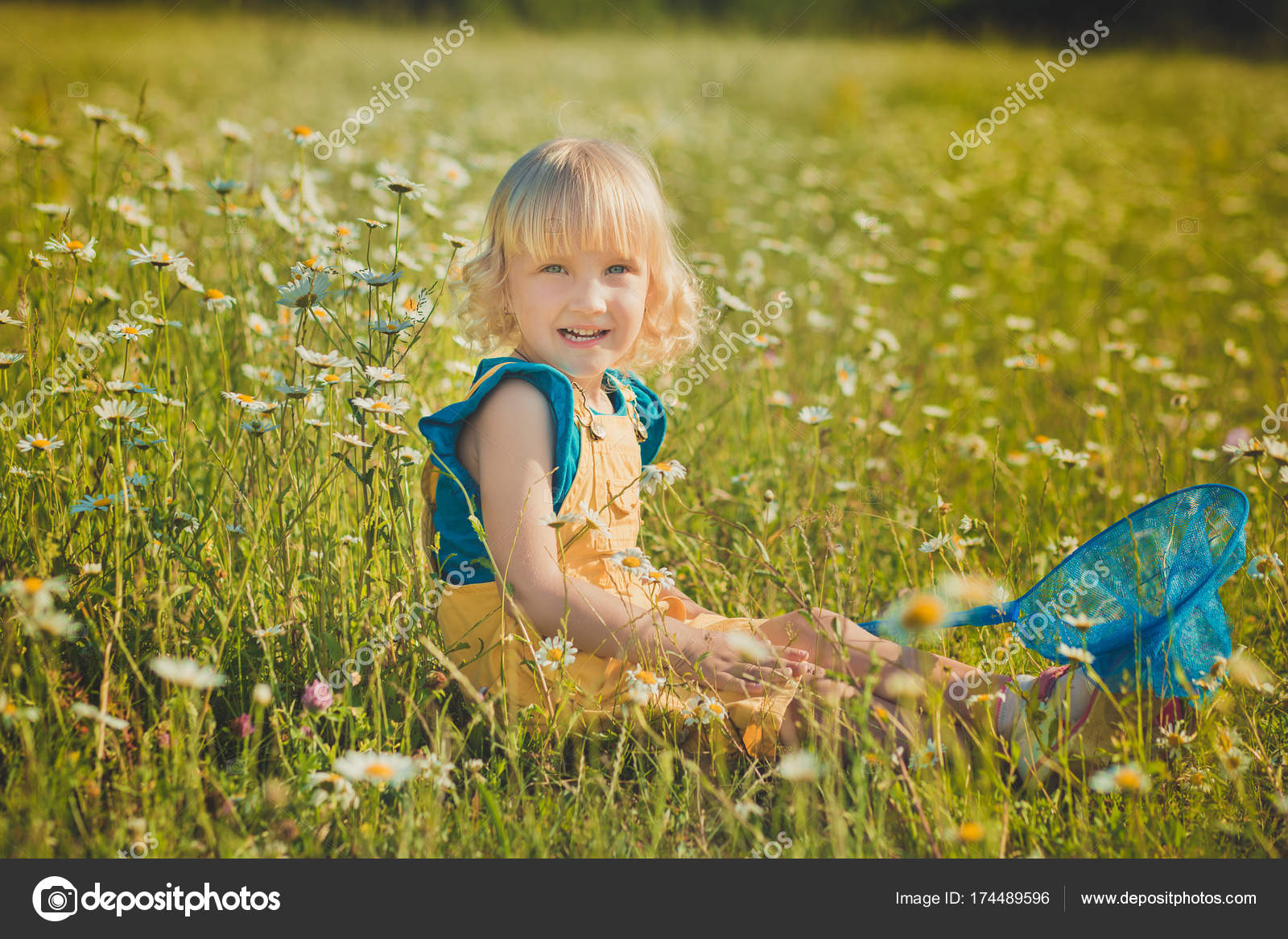 cute beautiful girl baby with scoop ring sweep net on daisy meadow