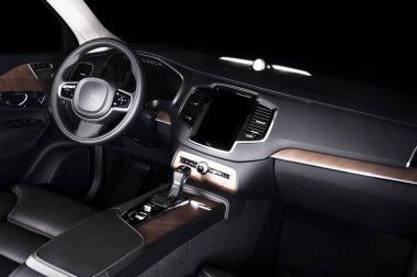 Modern luxury prestige car interior, dashboard, steering wheel. Black perforated leather interior. wood panels. Isolated windows, clipping path included