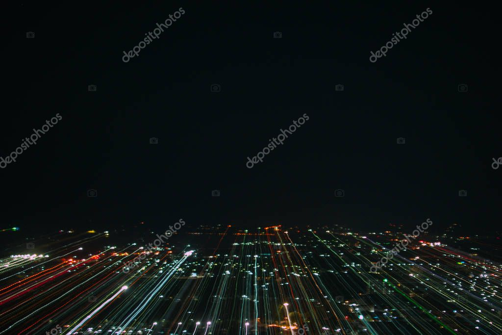 light lines with long exposure,  speed motion abstract background in the dark night ,  blast zoom effect , zoom burst of light in the city