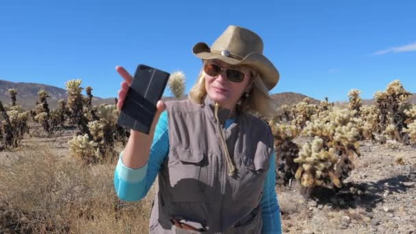 Travel Blonde Woman Looking On Clinging To Her Phone The Cholla Cactus
