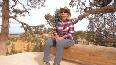 Woman Tourist At Canyon Resting Sitting On A Wooden Bench At A Hiking Trail 4K