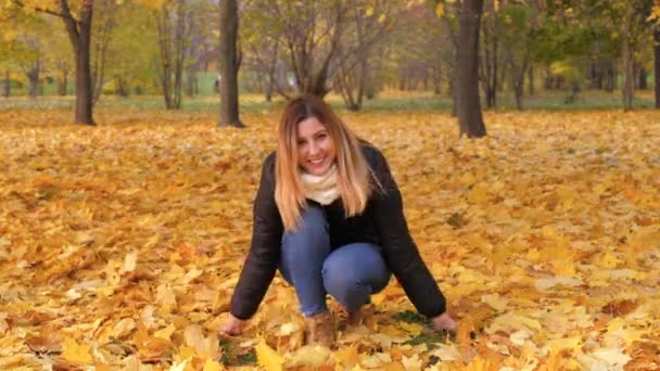 Playful Woman Throwing Autumn Leaves Laughing In Colorful Forest Foliage 4K