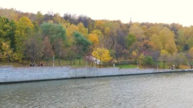 View Of Sailing Boats On A Stone Embankment With Colorful Trees In Autumn Park