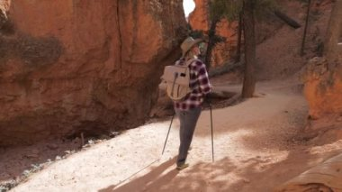 Woman Hiking Footpaths In Amazing Beautiful Bryce Canyon With Orange Mountains