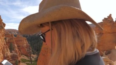 Woman Tourist Making Photo On Smartphone Views Of The Valley Of Bryce Canyon