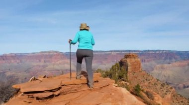 Woman Hiking In Grand Canyon Is Coming To The Observation Point And Arms Up