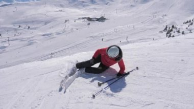 Skier Woman Fell On The Ski Slope And Trying To Stand On The Feet